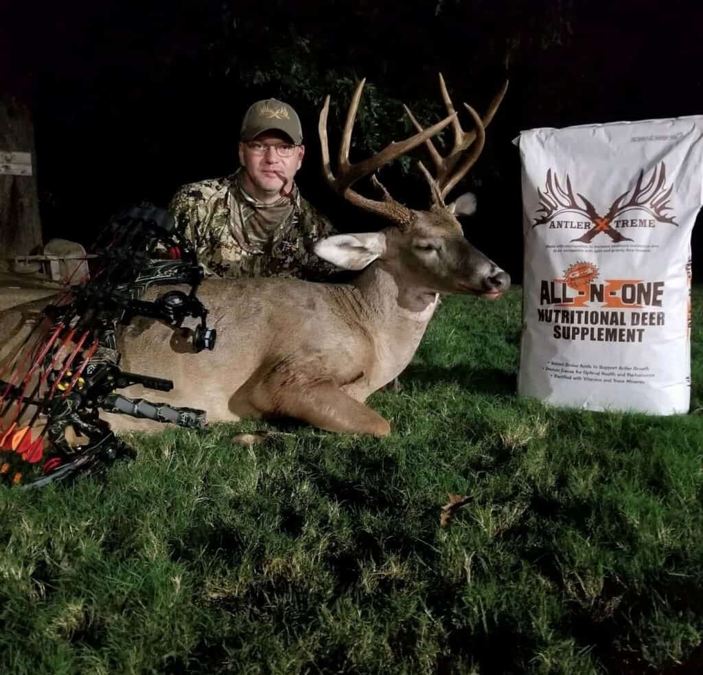Hunter with mineral supplement and whitetail